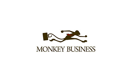 running monkey holding suitcase with his tail logo design