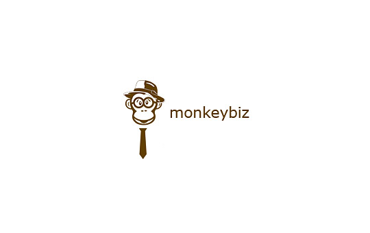 smart monkey with tie and glasses logo design
